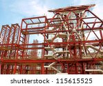 A major construction project with steel girders and scaffolding - stock photo