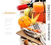 Thanksgiving table setting with pumpkins and candle - stock photo