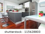 Modern interior of open-plan kitchen and living room - stock photo