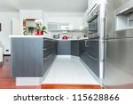 Kitchen interior in modern designed home - stock photo