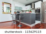 Beautiful modern kitchen in designer house - stock photo