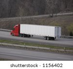 red semi tractor trailer with