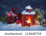Burning Lantern In The Snow At...