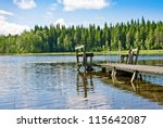 Dock Or Pier On Lake In Summer...