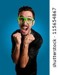 man screaming with green eyeglasses on blue  background - stock photo