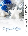 Blue and silver xmas baubles on holiday background with copy space - stock photo