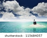 A businessman get stuck on island. A concept of businessman facing a dead end, frustration and hopeless situation in business. Can also be use to illustrate unemployment or financial crisis concept. - stock photo
