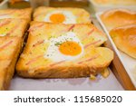bread slices with fried egg, ham and seasoning - stock photo