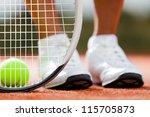 legs of sportive girl near the... | Shutterstock . vector #115705873