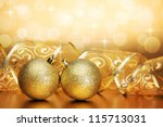 Christmas bauble with curled ribbon on holiday background - stock photo