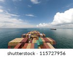 Cargo ships entering one of the busiest ports in the world, Singapore. - stock photo