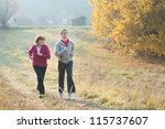 mom and son jogging in a meadow   Shutterstock . vector #115737607