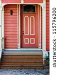 Traditional red painted wooden door and porch - stock photo