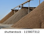 Very large piles of almonds ready for processing, different varities - stock photo
