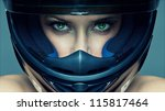 Sexy woman in helmet on blue background - stock photo