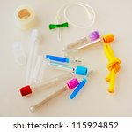 Test tubes, tourniquet, butterfly needle and other medical equipment - stock photo