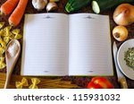 Top view of an empty recipe book surrounded of food ingredients and kitchen utensils - stock photo