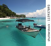 Floating Boat In Clear Water A...