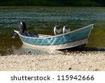 Drift fishing  boat on the shore of the Umpqua River in Oregon - stock photo