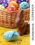 Easter eggs, cake, basket and bunny shape chocolate - stock photo