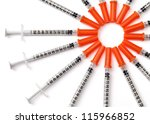 Medical syringes making a circle shape isolated on white. - stock photo