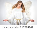 Woman In Angel Costume With...