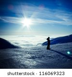 Stock photo ski traveler woman silhouette in amazing winter mountains landscape over the clouds opposite to 116069323