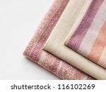 A pile of cloths of different texture on a white background - stock photo