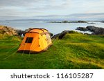 Orange Camping Tent On A Shore...