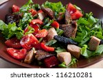 Vegetable salad with roasted pork and shiitake mushrooms - stock photo