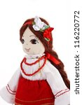Pretty stuffed doll in red saran - stock photo