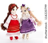 Pair of stuffed dolls on white background - stock photo