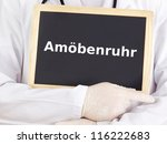 Small photo of Doctor shows information on blackboard: amoebiasis