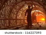 Silhouette of workers in mine - stock photo