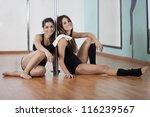 two young women taking a break... | Shutterstock . vector #116239567