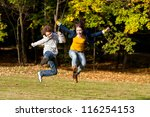 girl and boy jumping  running... | Shutterstock . vector #116254153