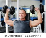 the man with dumbbells in... | Shutterstock . vector #116254447