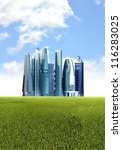 Futuristic city background with green  environmental friendly grassland foreground - stock photo