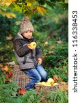 happy child eating an apple... | Shutterstock . vector #116338453