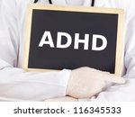 Doctor shows information on blackboard: adhd - stock photo
