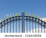 Iron fence opens and closes from the middle. - stock photo