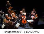"DNEPROPETROVSK, UKRAINE-OCT. 22:""Four seasons"" Chamber Orchestra - main conductor Dmitry Logvin perform music of Christoph Willibald Ritter von Gluck on Oct. 22, 2012 in Dnepropetrovsk, Ukraine - stock photo"
