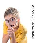 Child aged 10-12 years looking through a magnifying glass. - stock photo