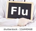 Doctor shows information on blackboard: flu - stock photo
