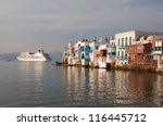 Little Venice on Mykonos and the cruise ship at sunset... - stock photo