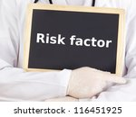 Doctor shows information on blackboard: risk factor - stock photo