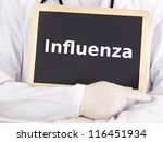 Doctor shows information on blackboard: influenza - stock photo