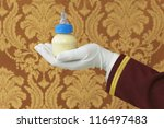 Butler's Hand With Bottle Of...