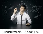 young man dreams of space travel | Shutterstock . vector #116504473