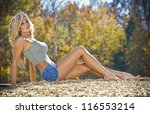 A blonde model posing outdoors at a park - stock photo